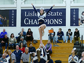 Cheerleader flying a lib