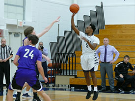 LHS basketball player shoots the ball.