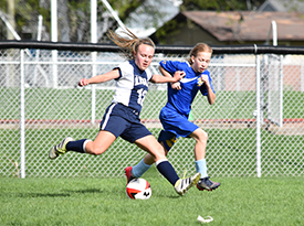LJHS Girls Soccer player kicks the ball