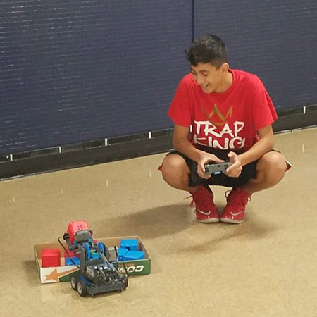 8th-Grade Student practicing with his bot