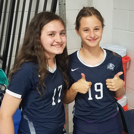 Two 7th-Grade Volleyball Players smilling