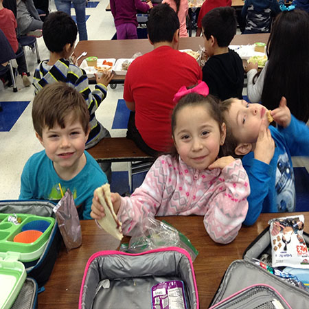 Schiesher students enjoying a good lunch with friends.