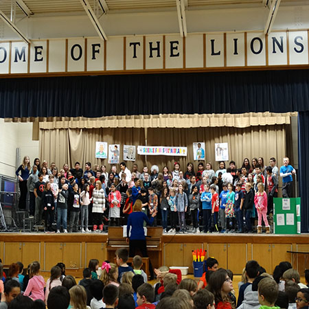 Schiesher students perform at an assembly.