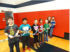 Students celebrate with a kindness chain