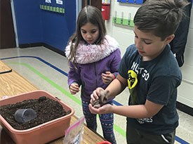 Student learning about soil