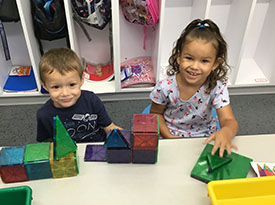 Students playing with magnatiles.