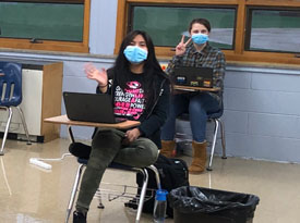 students in a classroom wearing masks