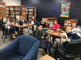 students in the library for book club